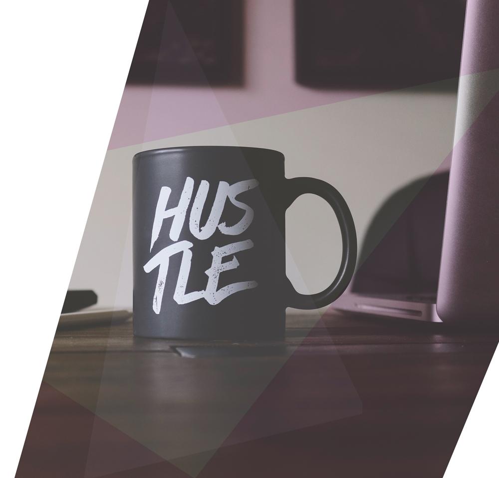 mug with HUSTLE text printed on